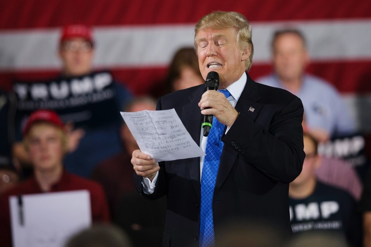 During a campaign rally Republican presidential candidate Donald Trump reads a statement made by Michelle Fields, on March 29, 2016 in Janesville, Wis. (Photo by Scott Olson/Getty)