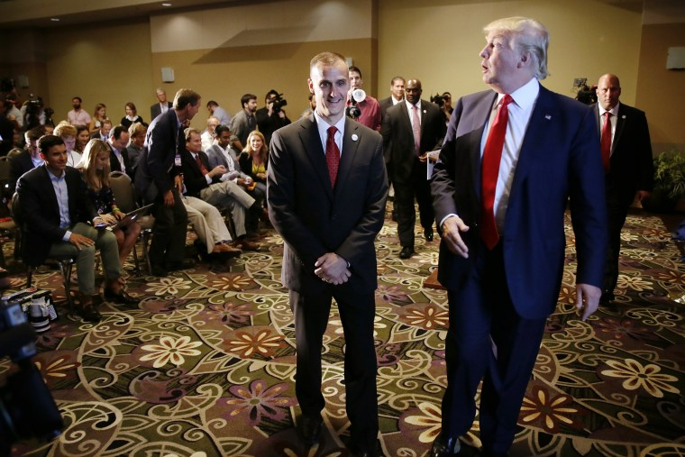 In this Aug. 25, 2015 file photo, Republican presidential candidate Donald Trump, right, walks with his campaign manager Corey Lewandowski after speaking at a news conference in Dubuque, Iowa. (Photo by Charlie Neibergall/AP)