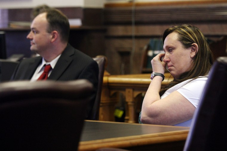 Kelli Jo Griffin, Montrose, Iowa, wipes away tears as she listens with her attorney to a not guilty verdict, March 20, 2014 in Keokuk, Iowa. (Photo by John Gaines/The Hawk Eye/AP)