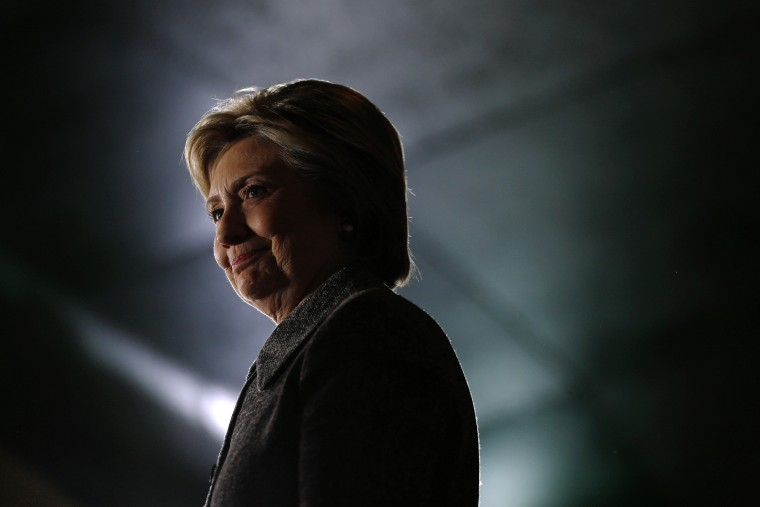 Democratic presidential candidate Hillary Clinton waits to be introduced during a rally at the Riverside Ballroom in Green Bay, Wis., March 29, 2016. (Photo by Patrick Semansky/AP)