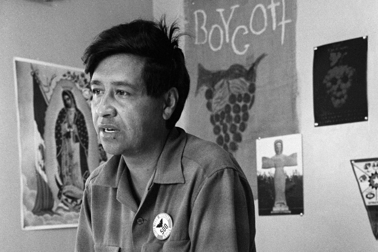 This 1965 file photo shows Cesar Chavez, farm worker labor organizer and leader of the California grape strike, in an office in California works from an office in 1965. (Photo by George Brich/AP)