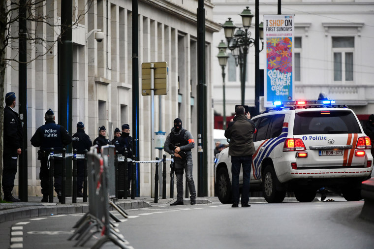 Police block the street outside the council chamber in Brussels, where two terrorism cases will behind closed doors, on March 31, 2016. (Photo by John Thys/AFP/Getty)