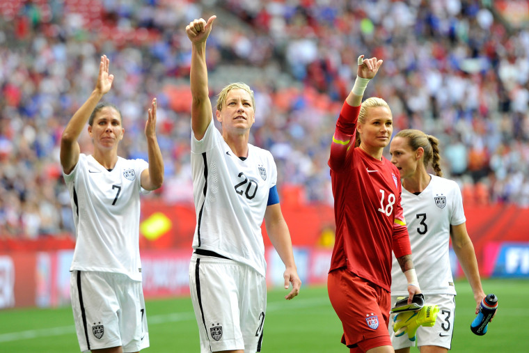 Shannon Boxx #7, Abby Wambach #20, Ashlyn Harris #18, and Christie Rampone #3 of the United States celebrate with teammates on June 16, 2015 in Vancouver, Canada. (Photo by Rich Lam/Getty)