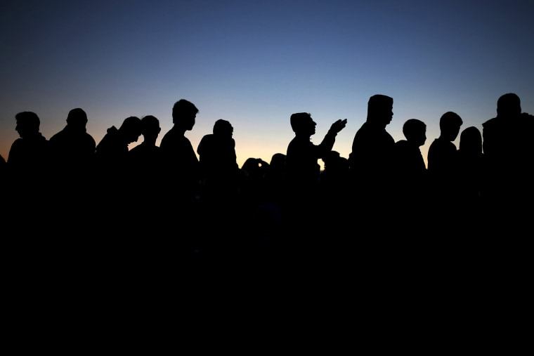 Migrants and refugees queue for food at a makeshift camp at the Greek-Macedonian border near the village of Idomeni, Greece, March 30, 2016. (Photo by Marko Djurica/Reuters)