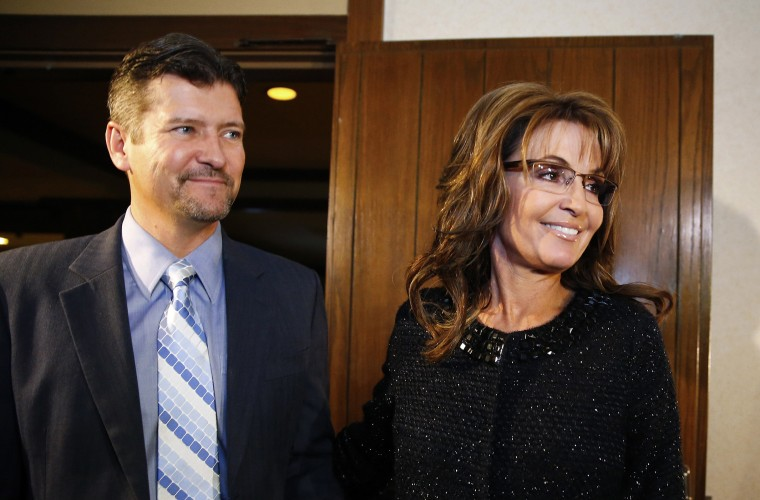 Former Republican governor of Alaska Sarah Palin and her husband Todd arrive for a celebration for evangelist Billy Graham's 95th birthday in Asheville, N.C., Nov. 7, 2013. (Photo by Chris Keane/Reuters)