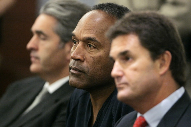 O.J. Simpson appears in court with his attorneys in Las Vegas, Sept. 19, 2007. (Photo by Barry Sweet/ZUMA)