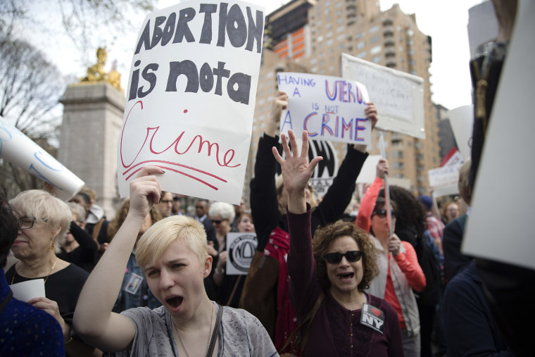 Kayla Forshey, left, participates in a rally to condemn Republican presidential candidate Donald Trump's remarks about women and abortion, March 31, 2016, in New York. (Photo by Mary Altaffer/AP)