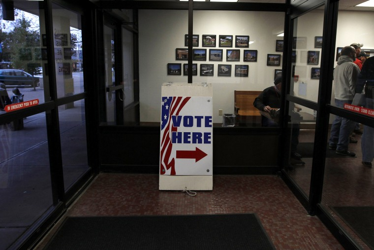 Signs direct voters to the Licking County Board of Elections to open in Newark, Ohio on Nov. 3, 2012. (Photo by Matt Sullivan/Reuters)