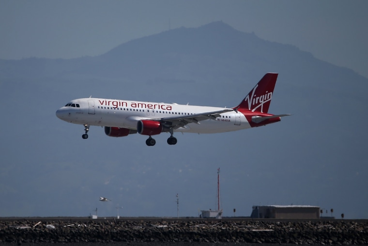 A Virgin America plane lands at San Francisco International Airport on March 29, 2016 in Burlingame, Calif. (Photo by Justin Sullivan/Getty)