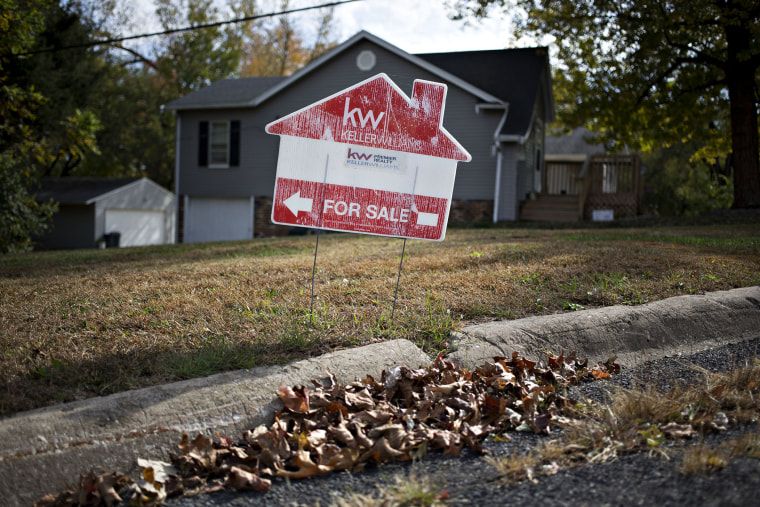 """A """"For Sale"""" sign stands outside a home in Peoria, Ill., Oct. 20, 2015. (Photo by Daniel Acker/Bloomberg/Getty)"""