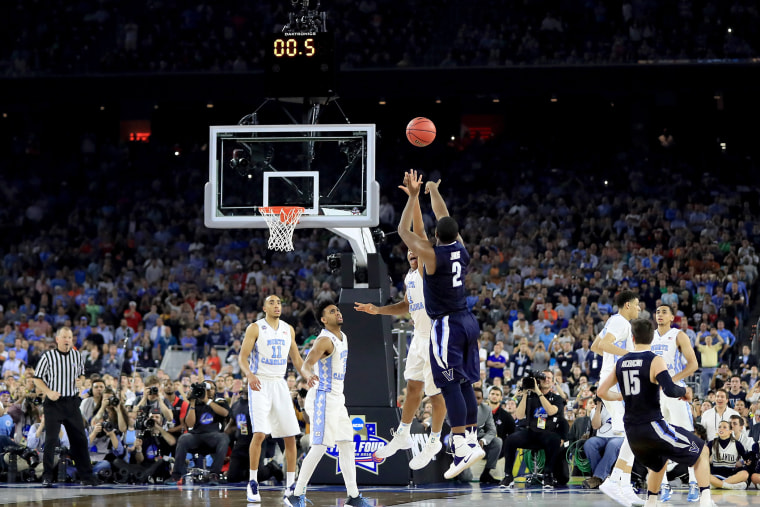 Kris Jenkins #2 of the Villanova Wildcats shoots the game-winning three pointer to defeat the North Carolina Tar Heels 77-74 in the 2016 NCAA Men's Final Four National Championship game on April 4, 2016 in Houston, Texas. (Photo by Ronald Martinez/Getty)