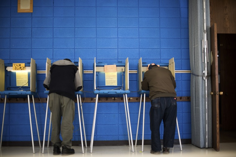 Voters cast their ballots at a polling station at the Albright United Methodist Church in Milwaukee, Wis., April 5, 2016. (Photo by Hilary Swift/The New York Times/Redux)
