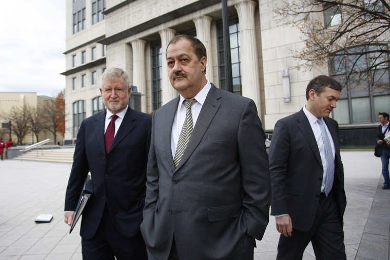 "Donald ""Don"" Blankenship, former chief executive officer of Massey Energy Co., center, and his attorney, left, exit the Robert C. Byrd U.S. Courthouse in Charleston, W. Va., on Dec. 3, 2015. (Photo by Calvin Mattheis/Bloomberg/Getty)"