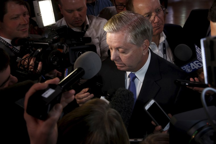 Senator Lindsey Graham is surrounded by reporters outside a Republican presidential candidates debate in Greenville, S.C., Feb. 13, 2016. (Photo by Jonathan Ernst/Reuters)