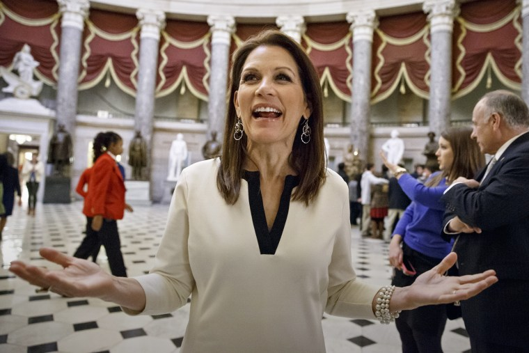 Rep. Michele Bachmann, R-Minn., speaks with reporters at the Capitol in Washington, Dec. 11, 2014. (Photo by J. Scott Applewhite/AP)