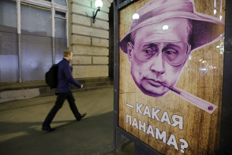 """""""Which Panama?"""" reads a poster at a bus stop in Moscow, Russia, April 6, 2016. In Russian """"panama"""" also means a bucket hat. (Photo by Sergei Karpukhin/Reuters)"""
