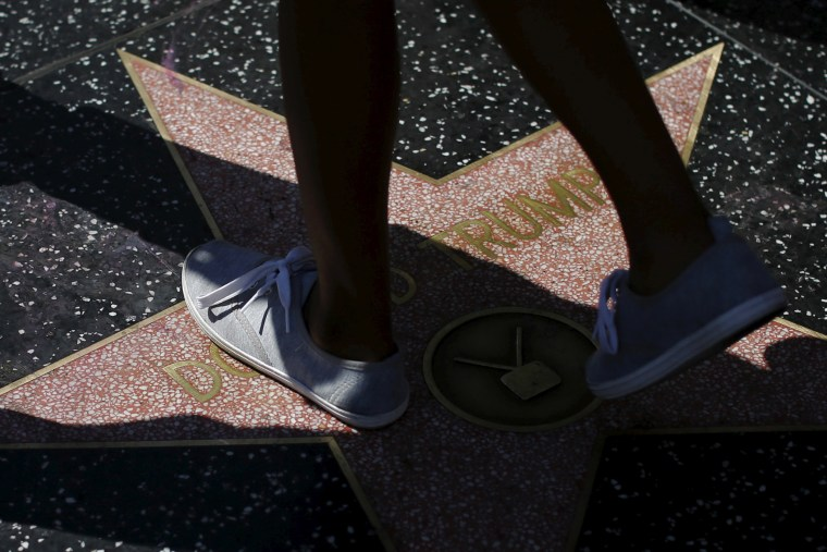 People walk on the star of Republican presidential candidate Donald Trump on the Hollywood Walk of Fame in Hollywood, Calif., April 5, 2016. (Photo by Mario Anzuoni/Reuters)