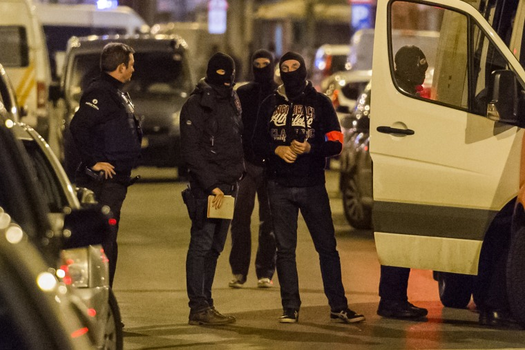 Police investigate an area where terror suspect Mohamed Abrini was arrested earlier in Brussels on April 8, 2016. (Photo by Geert Vanden Wijngaert/AP)
