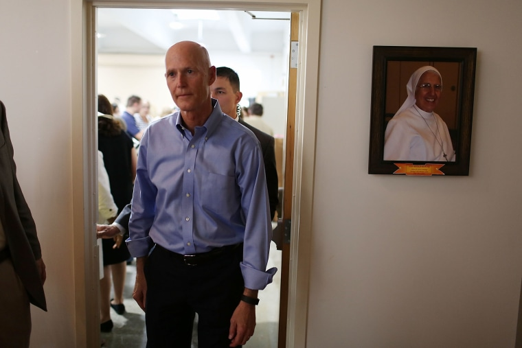 Florida Governor Rick Scott visits the Marian Center which offers services for people with intellectual disabilities on July 13, 2015 in Miami Gardens, Fl. (Photo by Joe Raedle/Getty)