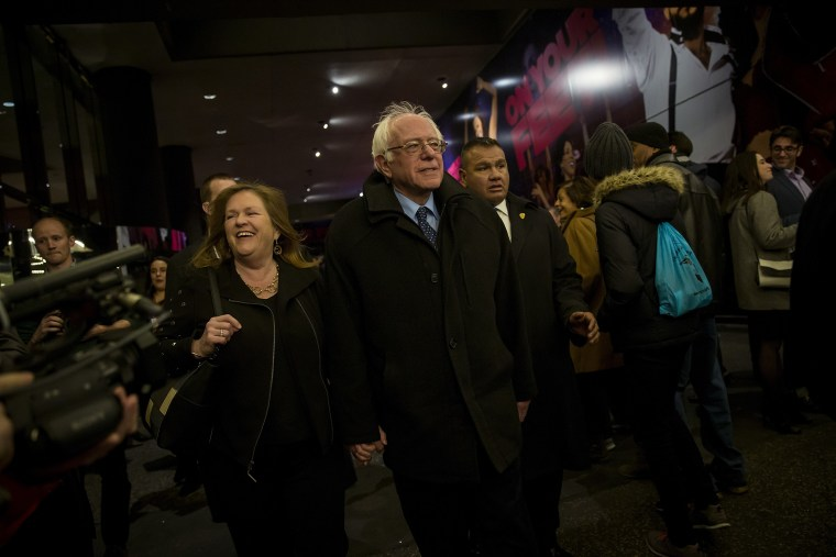 Democratic presidential candidate Sen. Bernie Sanders (D-VT) and his wife, Jane Sanders, walk through the Theatre District in Times Square, April 8, 2016 in New York City. (Photo by Eric Thayer/Getty)