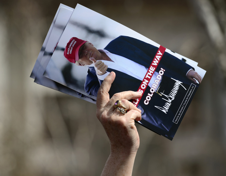 A woman holds leaflets for candidate Donald Trump at the Colorado District 2 meeting, April 8, 2016. (Photo by Kathryn Scott Osler/The Denver Post/Getty)