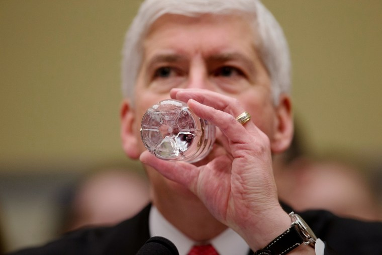 Michigan Gov. Rick Snyder drinks water as he testifies before a House Oversight and Government Reform Committee hearing in Washington, March 17, 2016. (Photo by Andrew Harnik/AP)