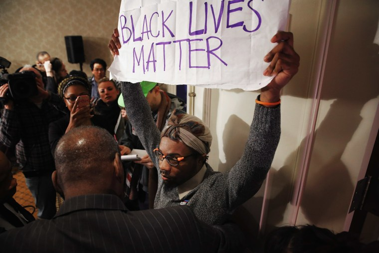 A Black Lives Matter protester is kept out of the main ballroom during the U.S. Conference of Mayors 84th Winter Meeting at the Capitol Hilton Jan. 20, 2016 in Washington, DC. (Photo by Chip Somodevilla/Getty)