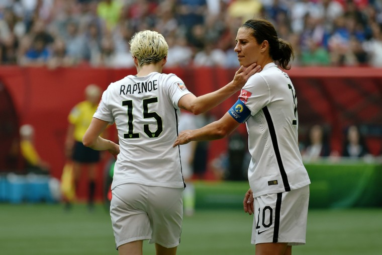 Carli Lloyd greets exiting teammate Megan Rapinoe during the FIFA Women's World Cup Final against Japan, which they won, at BC Place Stadium on July 5, 2015 in Vancouver, Canada. (Photo by Rich Lam/Getty)