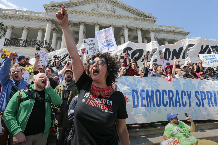 Alejandra Pablos of Arizona leads a chant as voting rights reform demonstrators stage a sit-in at the Capitol in Washington, April 11, 2016, urging lawmakers to take money out of the political process. (Photo by J. Scott Applewhite/AP)