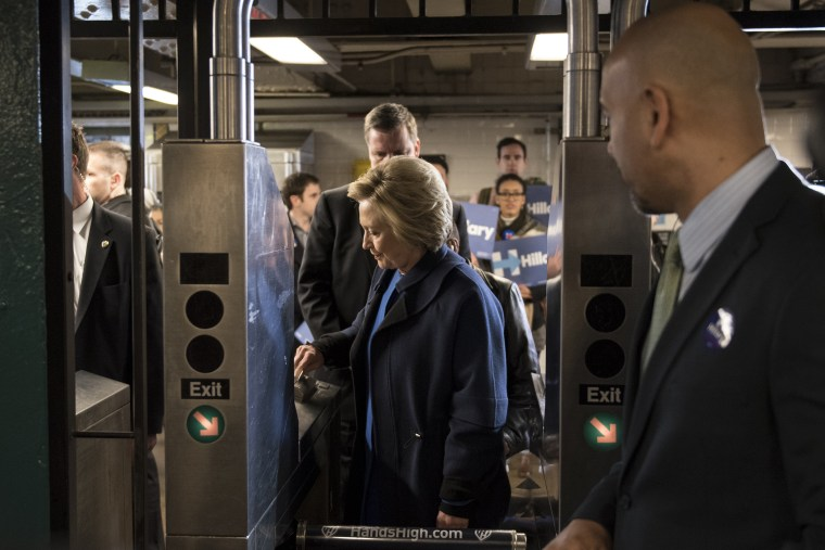 Democratic presidential candidate Hillary Clinton swipes a MetroCard to ride the No. 4 train as she campaigns on April 7, 2016 in the Bronx borough of New York City. (Photo by Andrew Renneisen/Getty)