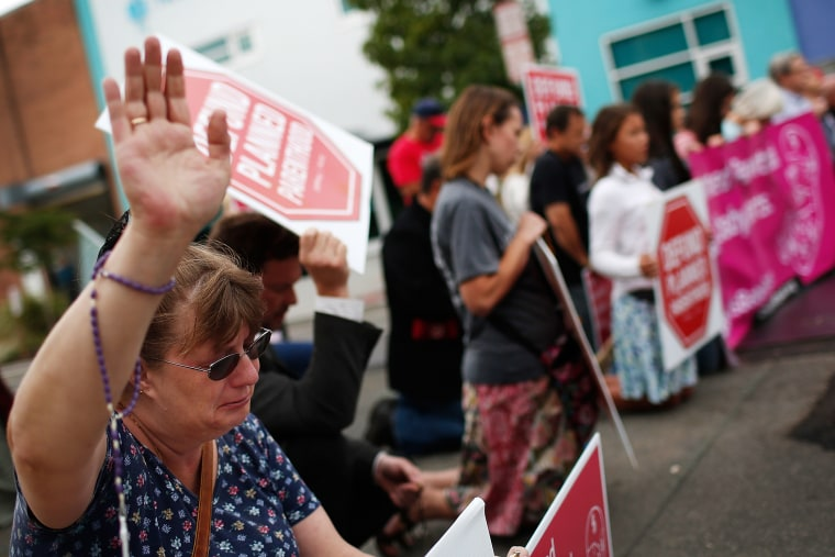 Right to Life advocate Linda Heilman prays during a sit-in in front of a proposed Planned Parenthood on Sept. 21, 2015 in Washington, DC. (Photo by Win McNamee/Getty)