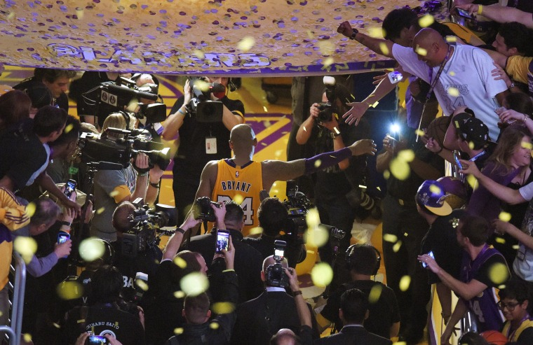 Los Angeles Lakers forward Kobe Bryant walks off the court after finishing his last NBA basketball game before retirement, against the Utah Jazz on April 13, 2016, in Los Angeles. (Photo by Mark J. Terrill/AP)