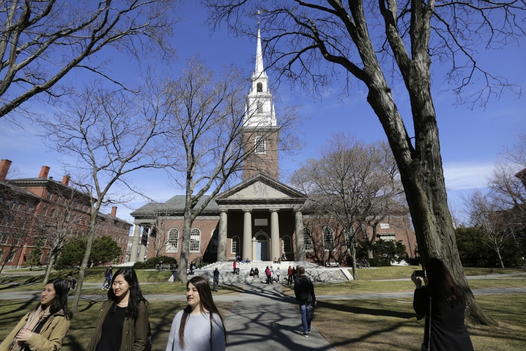 People walk near Memorial Church on the campus of Harvard University, in Cambridge, Mass., March 13, 2016. (Photo by Steven Senne/AP)