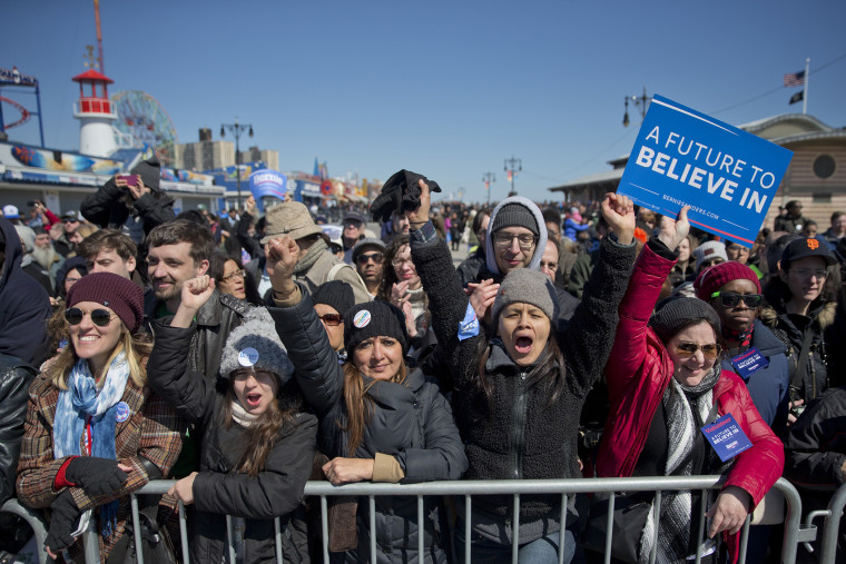 Supporters cheers as Democratic presidential candidate, Sen. Bernie Sanders, I-Vt., speaks during a rally on the Coney Island boardwalk in the Brooklyn borough of New York, April 10, 2016. (Photo by Mary Altaffer/AP)