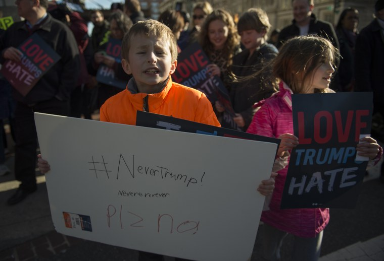 Ten-year-old Henry and seven-year-old Ruby protest outside Verizon Center where Republican presidentil candidate Donald Trump spoke during AIPAC 2016 Policy Conference on March 21, 2016 in Washington, DC. (Photo by Molly Riley/AFP/Getty)