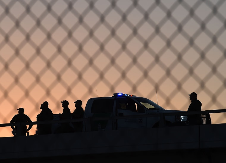 U.S. Border Patrol officers keep along the border fence separating U.S. and Mexico in the town of El Paso, Texas on Feb. 17, 2016. (Photo by Mark Ralston/AFP/Getty)
