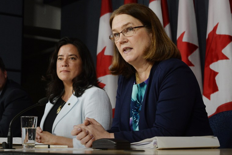 Canada's Health Minister Jane Philpott, right, speaks as Justice Minister Jody Wilson-Raybould listens at a news conference in Ottawa on April 14, 2016. (Photo by Adrian Wyld/The Canadian Press/AP)