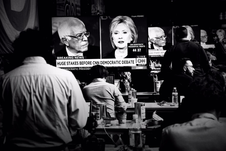 Bernie Sanders and Hillary Clinton are seen sparring on televisions in the reporters' filing room at the CNN Debate in Brooklyn, N.Y., April 14, 2016. (Photo by Mark Peterson/Redux for MSNBC)