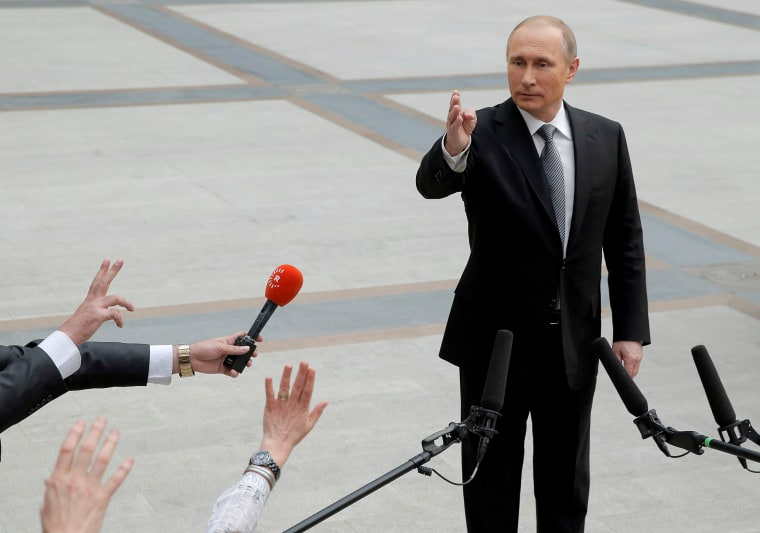 Russian President Vladimir Putin gestures during a meeting with journalists after a live broadcast nationwide call-in in Moscow, Russia, April 14, 2016. (Photo by Maxim Shemetov/Reuters)