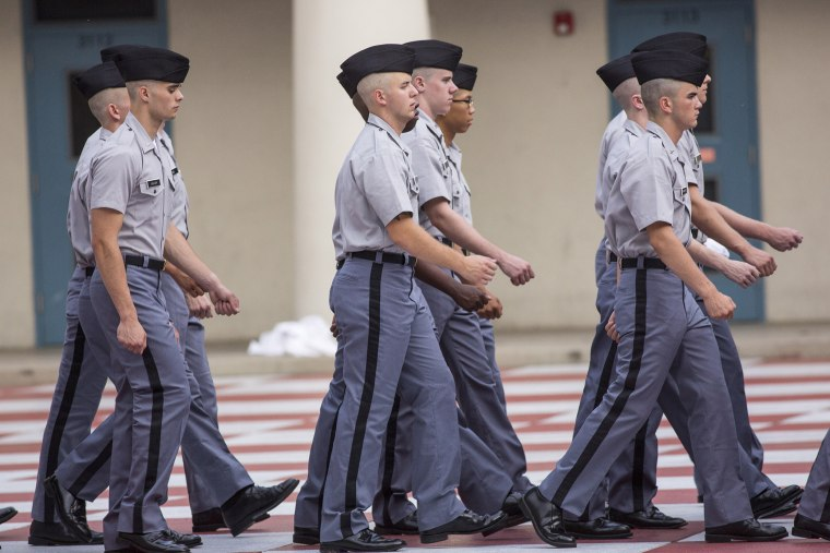 Citadel freshman cadets known as knobs drill for the first time in their new uniforms on Aug. 19, 2013 in Charleston, S.C. (Photo by Richard Ellis/Getty)
