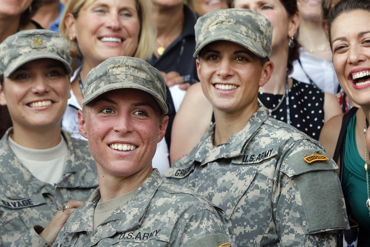 In this Aug. 21, 2015, file photo, Army 1st Lt. Shaye Haver, center, and Capt. Kristen Griest, right, pose for photos with other female West Point alumni after an Army Ranger school graduation ceremony at Fort Benning, Ga. (Photo by John Bazemore/AP)