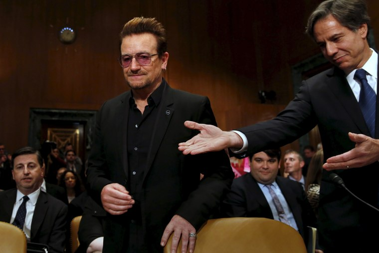 Deputy Secretary of State Antony Blinken welcomes U2 lead singer Bono to testify before a Senate subcommittee hearing on Capitol Hill in Washington, April 12, 2016. (Photo by Yuri Gripas/Reuters)