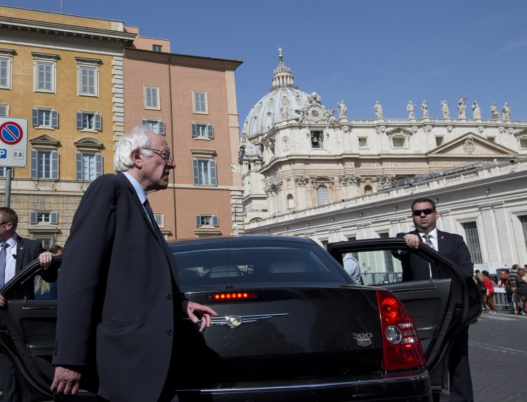 U.S. presidential candidate Bernie Sanders, backdropped by the dome of St. Peter's Basilica, at the Vatican, April 16, 2016. (Photo by Alessandra Tarantino/AP)