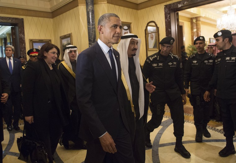U.S. President Obama walks alongside Saudi's newly appointed King Salman at Erga Palace in Riyadh on Jan. 27, 2015 following his arrival in Saudi Arabia. (Photo by Saul Loeb/AFP/Getty)