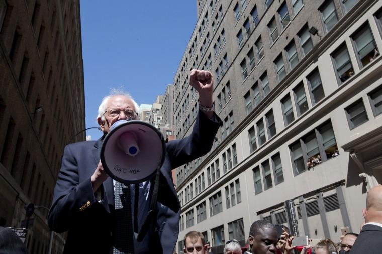 Democratic presidential candidate Sen. Bernie Sanders, I-Vt. speaks to Communication Workers of America (CWA) picketers in midtown Manhattan, N.Y., April 18, 2016. (Photo by Mary Altaffer/AP)