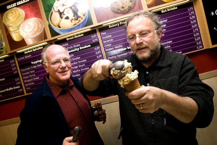 American ice cream makers Ben Cohen and Jerry Greenfield, founders of the brandBen & Jerry's, give out ice creams for free in their shop, Feb. 22, 2010. (Photo by Ade Johnson/AFP/Getty)