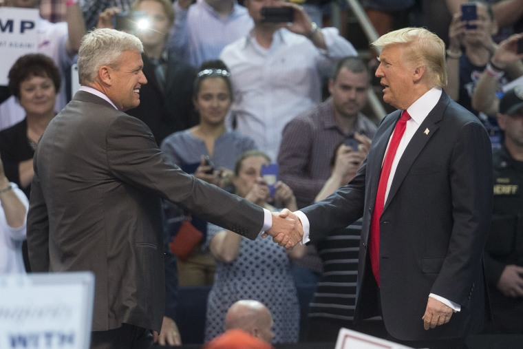 Buffalo Bills head coach Rex Ryan, left, shakes hands with Republican presidential candidate Donald Trump, after introducing him during a campaign stop at the First Niagara Center, April 18, 2016, in Buffalo, N.Y. (Photo by John Minchillo/AP)