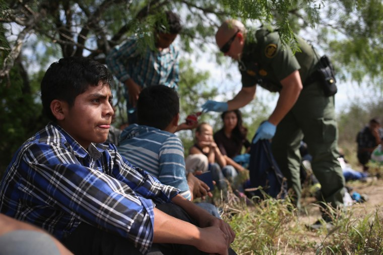 A Border Patrol agent collects personal items from Central American families who crossed into the United States seeking asylum on April 14, 2016 in Roma, Texas. (Photo by John Moore/Getty)