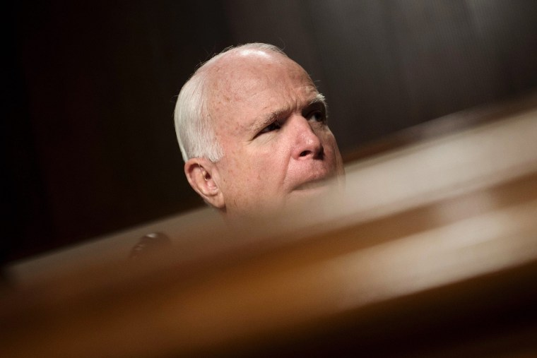 Committee chairman Senator John McCain (R-AZ) listens during a hearing of the Senate Armed Services Committee, March 8, 2016 in Washington, DC. (Photo by Brendan Smialowski/AFP/Getty)