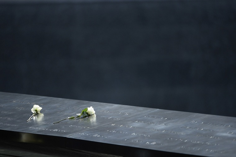Roses sit on the edge of the south pool of the 9/11 Memorial in New York, N.Y., on Sept. 25, 2015. (Photo by CJ Gunther/EPA)